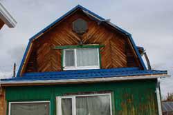 Дом без сайдинга до ремонта